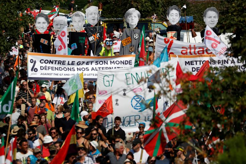 Thousands Join Anti-G7 March as World Leaders Fly into France for Summit