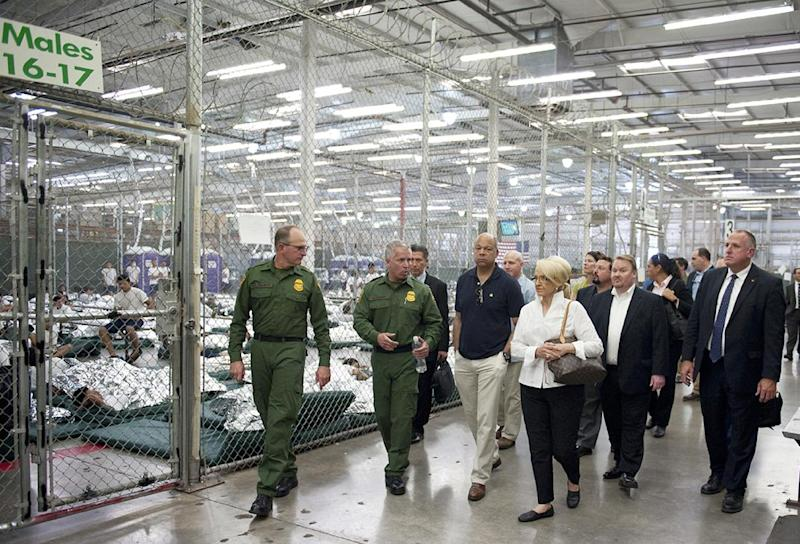 US Secretary of Homeland Security Jeh Johnson (C) and Arizona Governor Jan Brewer visit the US Customs and Border Protection (CBP) Nogales Placement Center in Nogales, Arizona June 25, 2014
