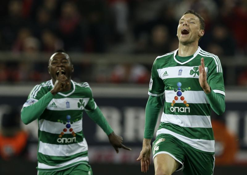 Panathinaikos' Marcus Berg of Sweden, right, celebrates after scoring the second goal of his team against Olympiakos during a Greek League soccer match at Georgios Karaiskakis stadium, in Piraeus port, near Athens, on Sunday, March 2, 2014. (AP Photo/Thanassis Stavrakis)