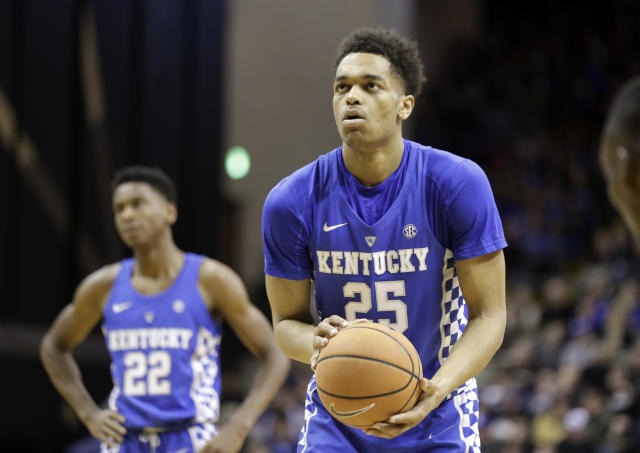 Kentucky forward P. J. Washington (25) shoots a free throw against Vanderbilt in the second half of an NCAA college basketball game Saturday, Jan. 13, 2018, in Nashville, Tenn. Kentucky won 74-67. (AP Photo/Mark Humphrey)