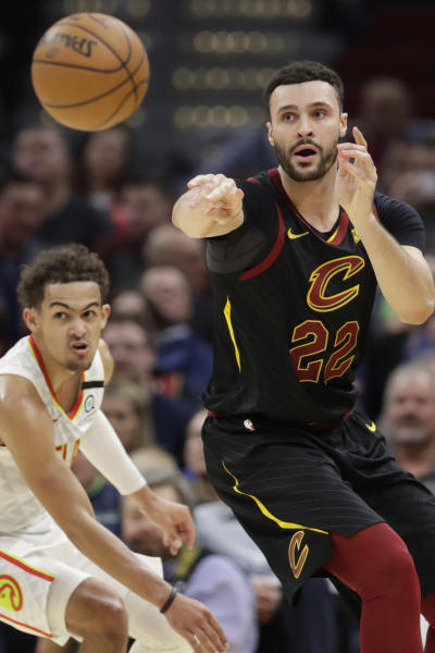 Cleveland Cavaliers' Larry Nance Jr. (22) passes against Atlanta Hawks' Trae Young (11) in the second half of an NBA basketball game, Wednesday, Feb. 12, 2020, in Cleveland. The Cavaliers won 127-105. (AP Photo/Tony Dejak)