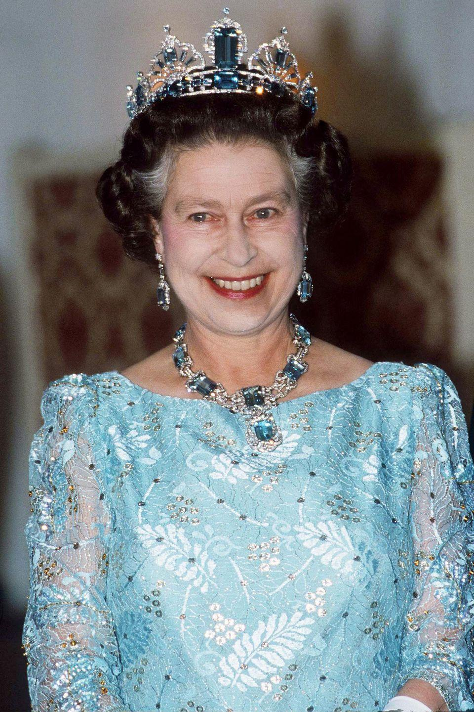 <p>This aquamarine and diamond necklace and earrings set was made by Mappin & Webb, and was given to the Queen in 1953 by the people and President of Brazil. She later had a matching tiara made by Garrard from an additional collection of Brazilian stones. It's rare in that it reflects the Queen's personal style–most of her other tiaras are heirlooms.<br></p>