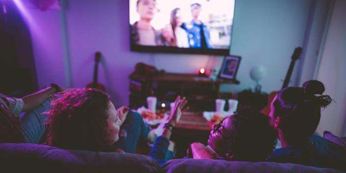 friends watching tv streaming at home