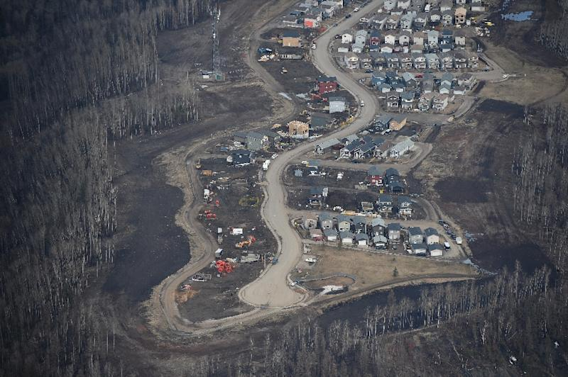 Aerial view of a neighborhood in Fort McMurray, Canada, where some homes have been rebuilt but many have not, one year after a massive forest fire