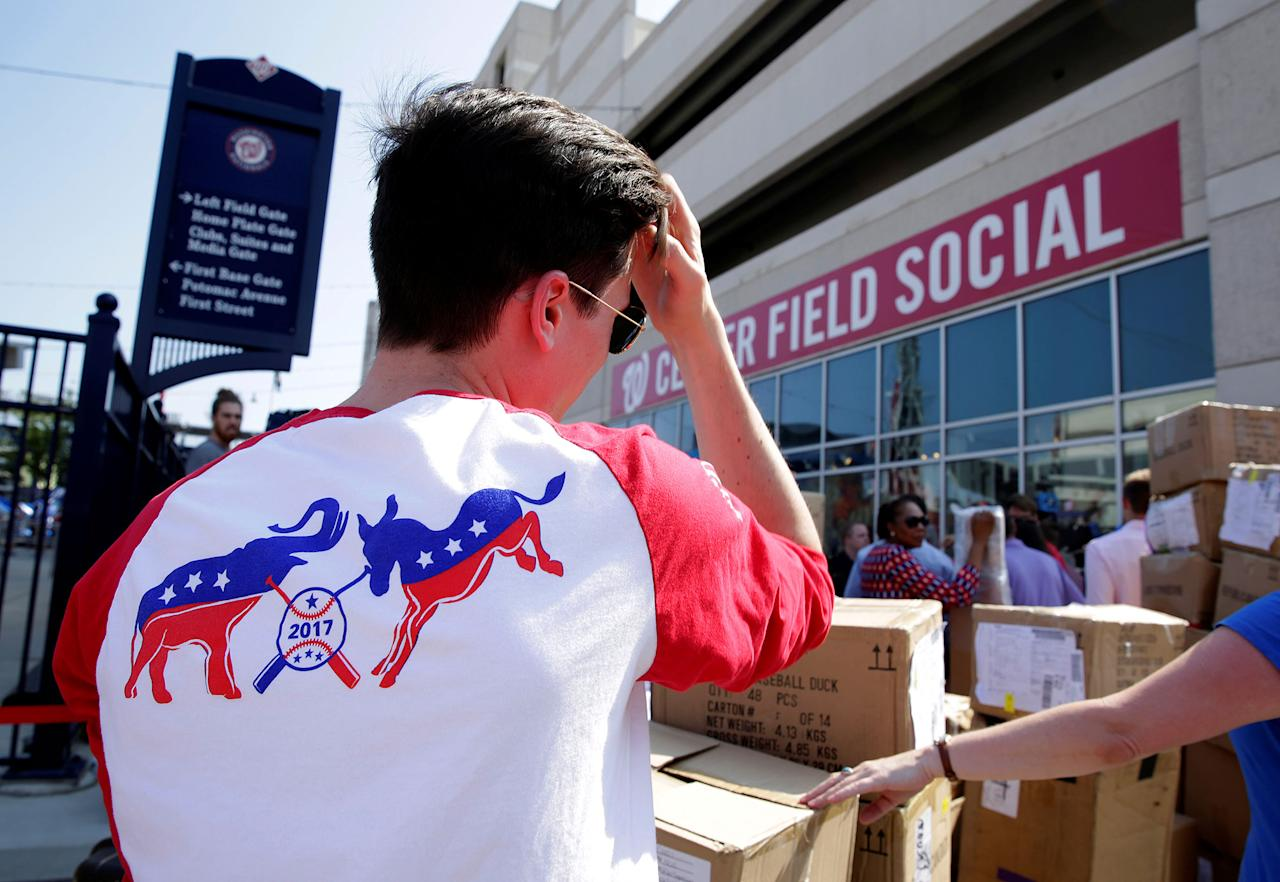 <p>A Democratic supporter waits in line before the Democrats and Republicans face off in the annual Congressional Baseball game at Nationals Park in Washington, June 15, 2017. (Photo: Joshua Roberts/Reuters) </p>