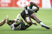 South Africa's Dewald Human, left, tackles Kenya's Harold Anduvate during an HSBC Canada Sevens rugby game in Vancouver, British Columbia, Saturday, Sept. 18, 2021. (Darryl Dyck/The Canadian Press via AP)