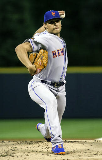 New York Mets relief pitcher Jason Vargas throws against the Colorado Rockies during the first inning of a baseball game, Tuesday, June 19, 2018, in Denver. (AP Photo/Jack Dempsey)