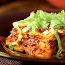 """<p>Intense, earthy and absolutely addictive, New Mexico's cheese enchiladas showcase red chile sauce at its most elemental, thickly blanketing tortillas and melted Cheddar. We've added some extra creaminess and body with locally popular pinto beans, to cut down on the classic's load of saturated fat. Top with shredded lettuce and minced onion. <a href=""""http://www.eatingwell.com/recipe/252651/cheese-enchiladas-with-red-chile-sauce/"""" rel=""""nofollow noopener"""" target=""""_blank"""" data-ylk=""""slk:View recipe"""" class=""""link rapid-noclick-resp""""> View recipe </a></p>"""