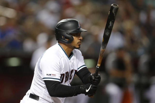 Arizona Diamondbacks' Eduardo Escobar watches his two-run triple against the Colorado Rockies during the sixth inning during a baseball game, Tuesday, Aug. 20, 2019, in Phoenix. (AP Photo/Rick Scuteri)