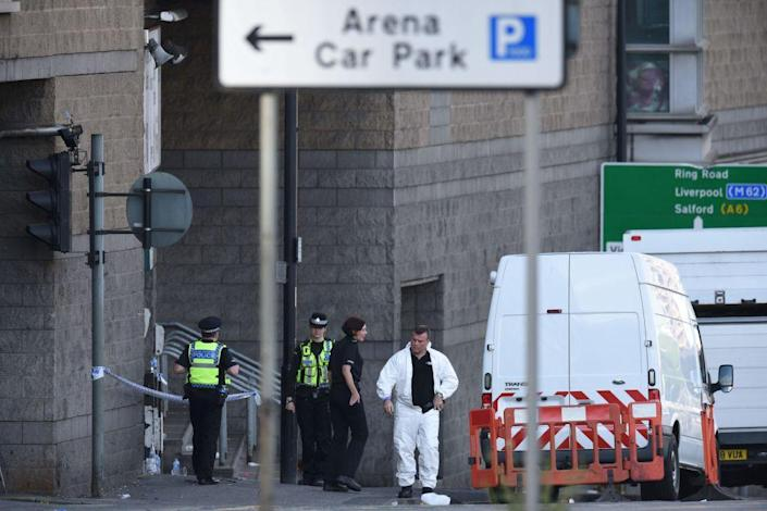 Members of the emergency services work near Manchester Arena following a terror attack at an Ariana Grande concert (Oli Scarff/AFP/Getty Images)