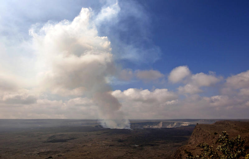 FILE - This Sept. 1, 2015 file photo shows volcanic gas rising from the lava lake in Kilauea's Halemaumau Crater in Hawaii Volcanoes National Park on Hawaii's Big Island. Hawaii residents and an organization representing federal workers filed a lawsuit against the Federal Aviation Administration on Wednesday, Oct. 4, 2017 seeking to force it to do something about tour helicopters buzzing their communities and national parks across the country. (AP Photo/Caleb Jones, File)