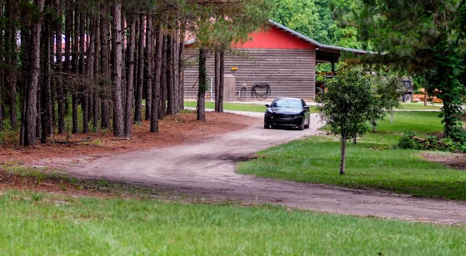 An unidentified car blocks the approach to the Murdaugh family property on Tuesday, June 8, 2021 near the dog kennels where Maggie Murdaugh, 52, and her son Paul Murdaugh, 22, died from gunshot wounds in an apparent homicide in Colleton County.
