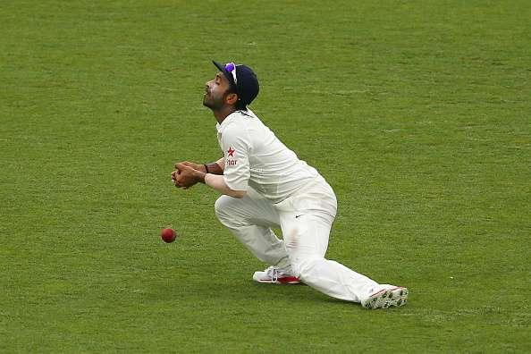 BRISBANE, AUSTRALIA - DECEMBER 18: Ajinkya Rahane of India drops a catch as Shaun Marsh of Australia plays a stroke high in the air during day two of the 2nd Test match between Australia and India at The Gabba on December 18, 2014 in Brisbane, Australia. (Photo by Cameron Spencer/Getty Images)