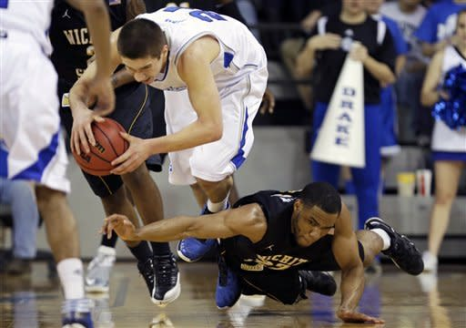 Wichita State guard Tekele Cotton, right, tries to steal the ball from Drake forward Joey King during the first half of an NCAA college basketball game on Wednesday, Jan. 2, 2013, in Des Moines, Iowa. (AP Photo/Charlie Neibergall)