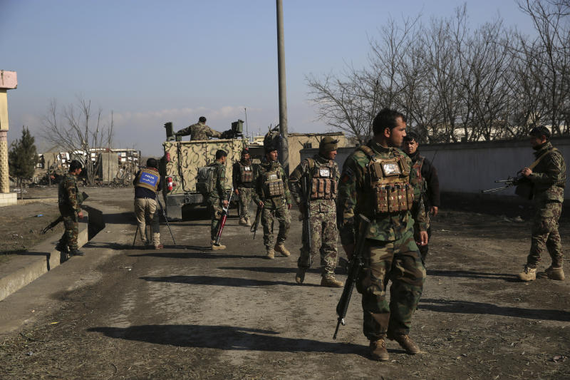Security personnel arrive near the site of an attack near the Bagram Air Base in Parwan province of Kabul, Afghanistan, Wednesday, Dec. 11, 2019. A powerful suicide bombing Wednesday targeted an under-construction medical facility near the Bagram Air Base, the main American base north of the capital Kabul, the U.S. military said. (AP Photo/Rahmat Gul)