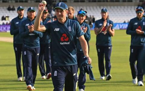 England's Chris Woakes is applauded by teammates as he leaves the pitch with the match-ball having taken five wickets - Credit: AFP