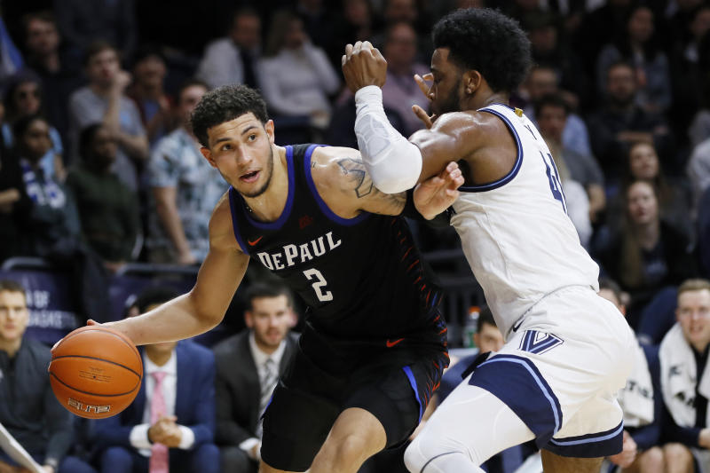DePaul's Jaylen Butz, left, tries to drive past Villanova's Saddiq Bey during the first half of an NCAA college basketball game, Tuesday, Jan. 14, 2020, in Villanova, Pa. (AP Photo/Matt Slocum)