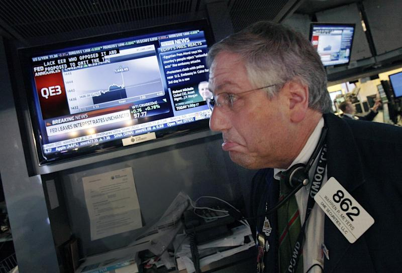 Trader Warren Meyers reacts to the announcement of the Federal Reserve as he watches a television screen on the floor of the New York Stock Exchange Thursday, Sept. 13, 2012. The Federal Reserve unleashed a series of aggressive actions Thursday intended to stimulate the still-weak economy by making it cheaper for consumers and businesses to borrow and spend. (AP Photo/Richard Drew)