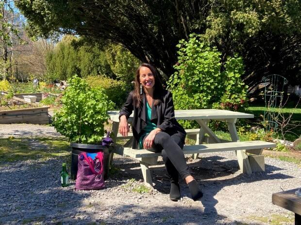"""Lyana Patrick sits in the communal garden in front of Vancouver City Hall. """"Public health and planning are actually very much intimately connected,"""" she says."""