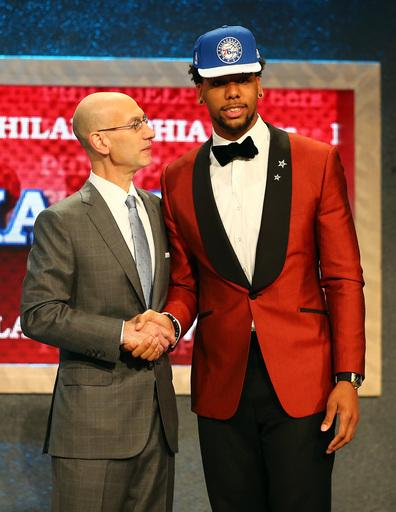 Adam Silver congratulates Jahlil Okafor on his successful lounge act. (Elsa/Getty Images)
