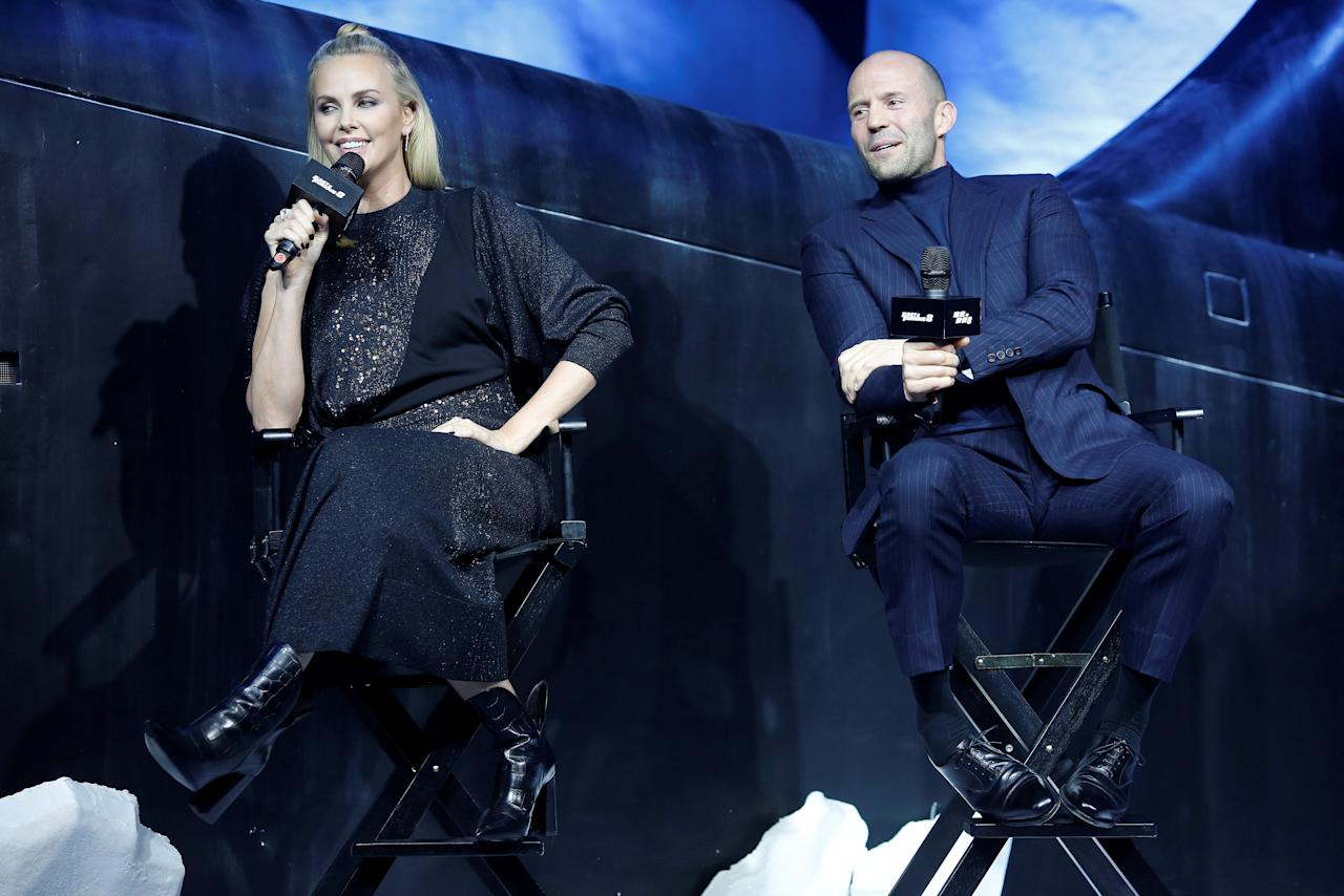 "Actors Charlize Theron (L) and Jason Statham attend a media event for the new film ""The Fate of the Furious"" in Beijing, China March 23, 2017. REUTERS/Aly Song"