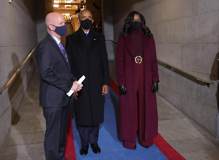 """Former Lady Michelle Obama arrived in D.C. <a href=""""https://www.teenvogue.com/story/michelle-obama-inauguration-outfit?mbid=synd_yahoo_rss"""" rel=""""nofollow noopener"""" target=""""_blank"""" data-ylk=""""slk:wearing a monochromatic look from designer Sergio Hudson"""" class=""""link rapid-noclick-resp"""">wearing a monochromatic look from designer Sergio Hudson</a> that single-handedly cured my depression. From her belt to her hair, everything was flawless. Former President Barack Obama matched her poise in a classic, all-black outfit."""