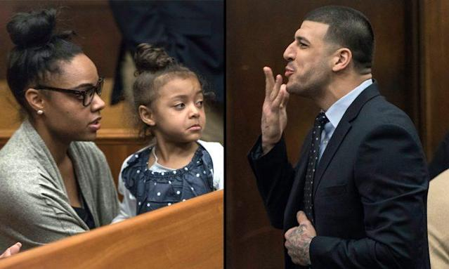 Aaron Hernandez blows his daughter a kiss in court. (AP)