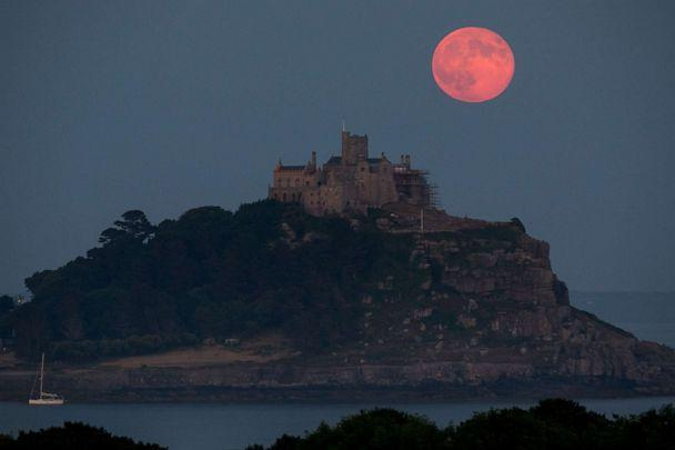 PHOTO: In this June 28, 2018, file photo, a strawberry moon rises behind St Michael's Mount in Mount's Bay, Cornwall, England. (Matt Cardy/Getty Images, FILE)