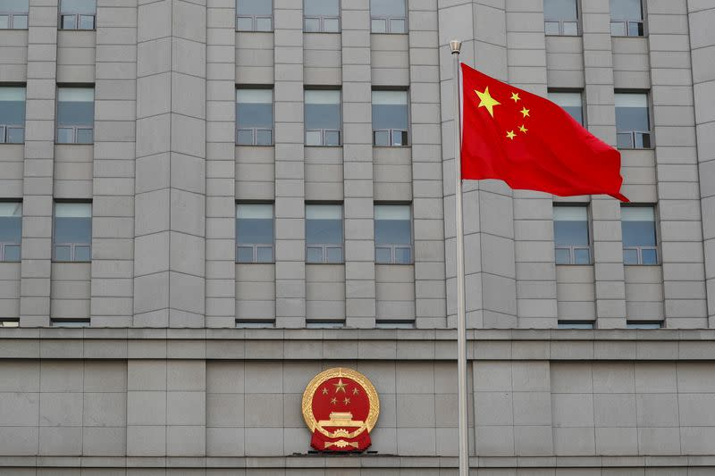 A Chinese national flag waves outside Beijing No. 2 Intermediate People's Court where Australian writer Yang Hengjun is expected to face trial on espionage charges, in Beijing