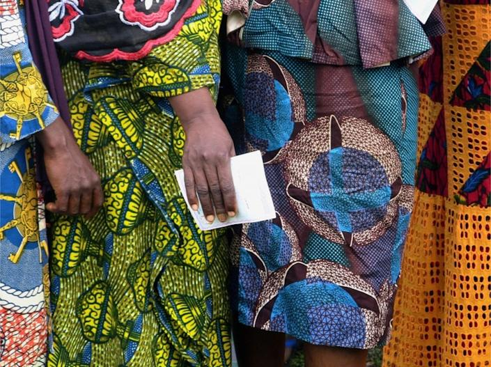 """Women wait to cast their ballots at a polling station during the Guinea""""s presidential election in Fria, Guinea October 18, 2020."""