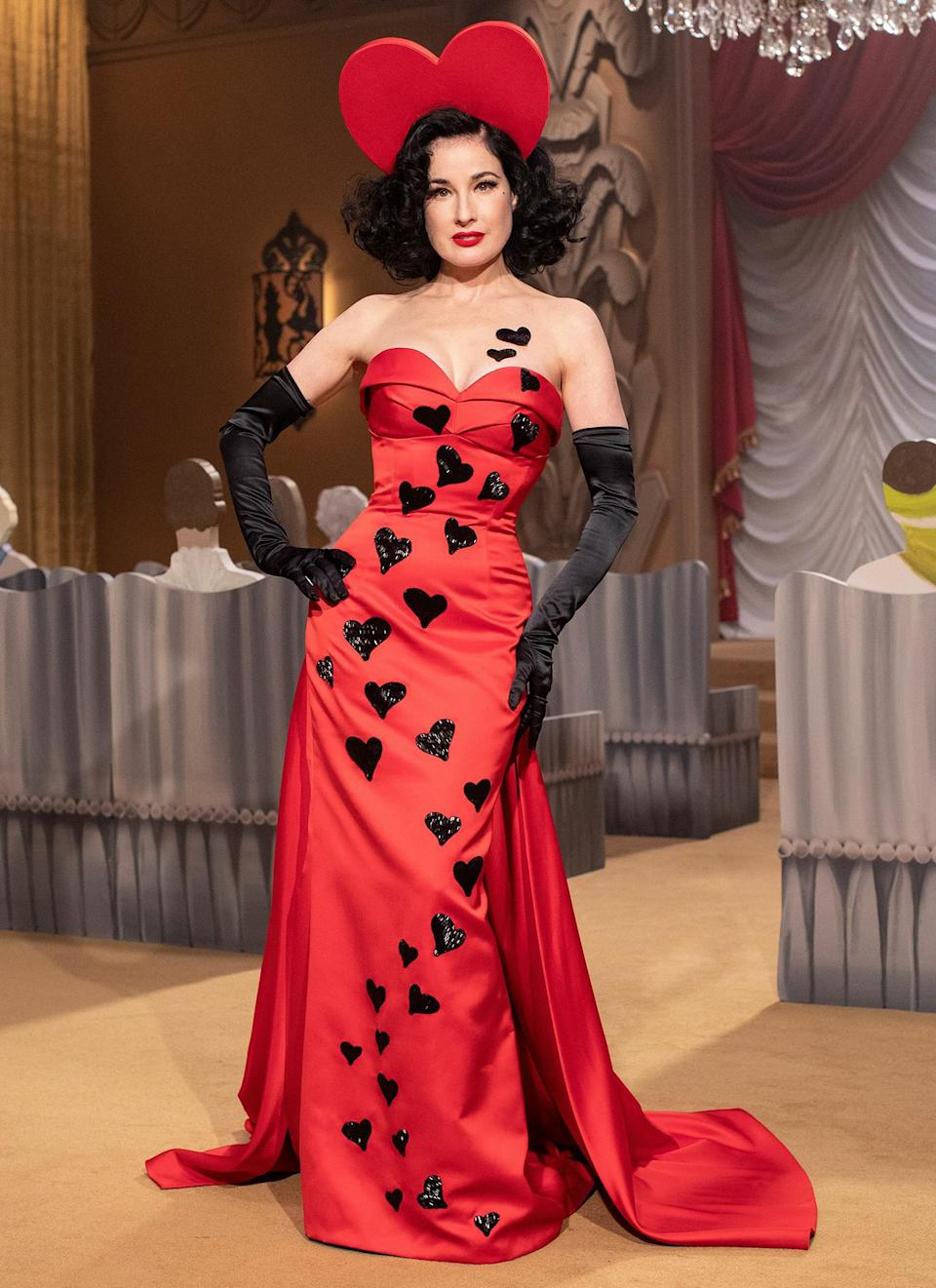 <p>Dita Von Teese wows in a red gown and a heart headpiece at the Milan Fashion Week Moschino fashion show on Thursday in Milan.</p>