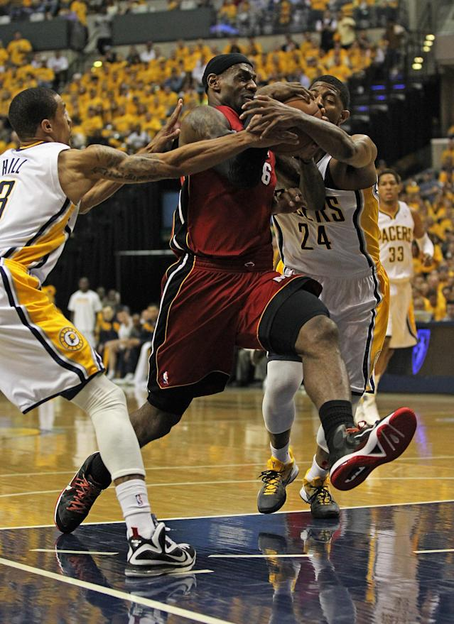 INDIANAPOLIS, IN - MAY 17: LeBron James #6 of the Miami Heat drives between George Hill #3 and Paul George #24 of the Indiana Pacers in Game Three of the Eastern Conference Semifinals in the 2012 NBA Playoffs at Bankers Life Fieldhouse on May 17, 2012 in Indianapolis, Indiana. NOTE TO USER: User expressly acknowledges and agrees that, by downloading and/or using this photograph, User is consenting to the terms and conditions of the Getty Images License Agreement. (Photo by Jonathan Daniel/Getty Images)
