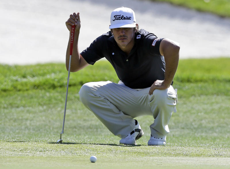 Brooks Koepka measures his putt on the ninth green during the second round of the Frys.com Open golf tournament on Friday, Oct. 11, 2013, in San Martin, Calif. (AP Photo/Marcio Jose Sanchez)