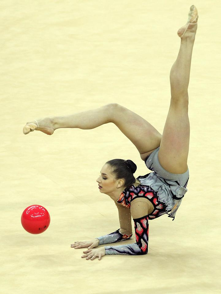 LONDON, ENGLAND - JANUARY 16:  Alexandra Piscupescu of Romania in action in the Individual All-Around during the FIG Rhythmic Gymnastics Olympic Qualification round  at North Greenwich Arena on January 16, 2012 in London, England.  (Photo by Ian Walton/Getty Images)