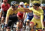 Local rivals: Despite a crushing reverse the day before, Primoz Roglic (left) congratulated leader Tadej Pogacar at the start of the final stage of the 2020 Tour de France