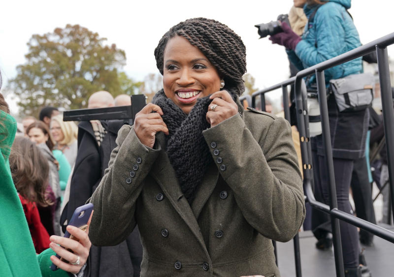 FILE - In this Nov. 14, 2018, file photo, then-Rep.-elect Ayanna Pressley, D-Mass., adjusts her coat after posing with other members of the freshman class of Congress for a group photo opportunity on Capitol Hill in Washington. Pressley, whose hair twists were an inspiration to young girls and part of her personal identity and political brand, revealed Thursday, Jan. 16, 2020, that she has gone bald due to alopecia. The freshman Massachusetts' Democrat made a touching video for The Root, the African American-focused online magazine, in which she revealed her bald head. (AP Photo/Pablo Martinez Monsivais, file)