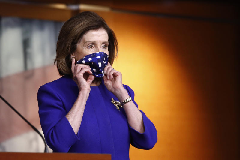 House Speaker Nancy Pelosi of Calif., adjusts her face mask to protect against the spread of the new coronavirus as she attends a news conference to announce members of the House Select Committee on the Coronavirus Crisis on Capitol Hill in Washington, Wednesday, April 29, 2020. (AP Photo/Patrick Semansky)
