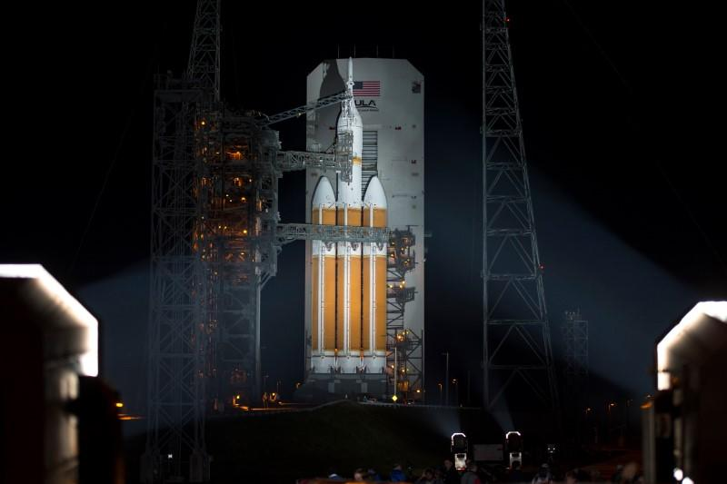 A United Launch Alliance Delta IV Heavy rocket with NASA?s Orion spacecraft mounted atop is seen in this handout photo after the Mobile Service Tower was finished rolling back at Cape Canaveral Air Force Station's Space Launch Complex 37