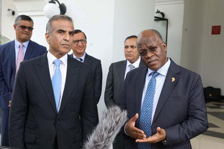 Tanzania's President John Magufuli (R) flanked by Bharti Airtel's chairman Sunil Mittal address the media at State House in Dar es Salaam, Tanzania January 11, 2019. Presidential Press Unit/Handout via REUTERS