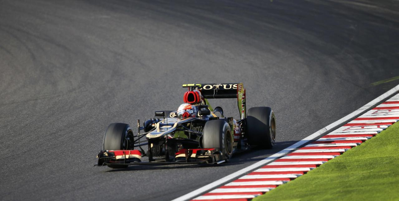 Lotus Formula One driver Romain Grosjean of France races during the Japanese F1 Grand Prix at the Suzuka circuit October 13, 2013. REUTERS/Issei Kato (JAPAN - Tags: SPORT MOTORSPORT F1)
