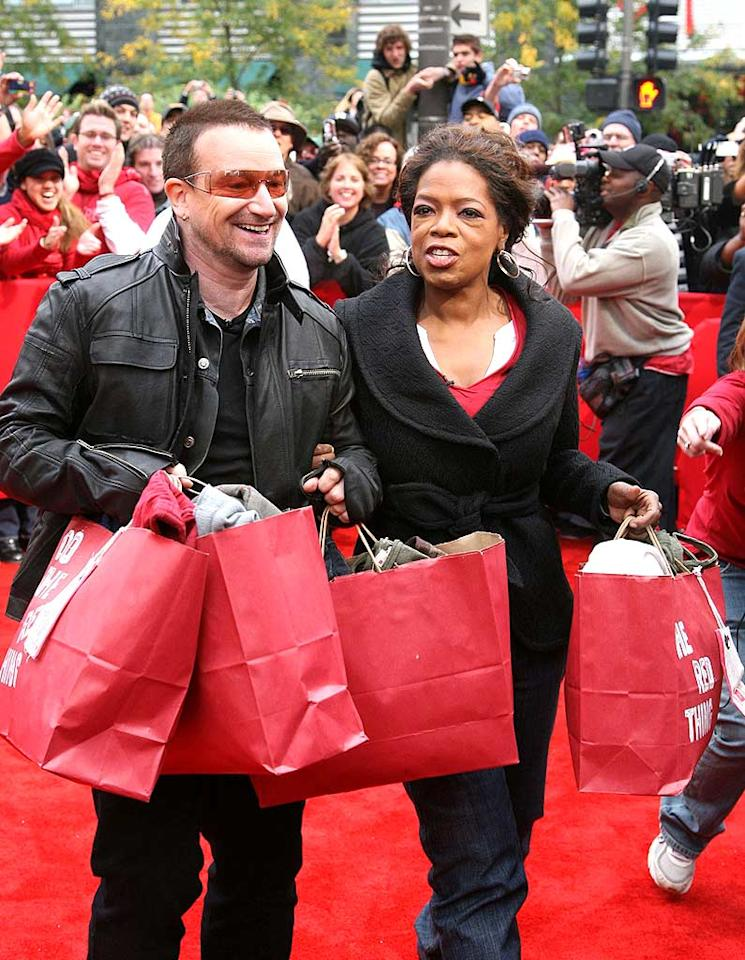 "Bono and Oprah Winfrey fill gift bags with (PRODUCT)RED merchandise from The Gap and Motorola. Proceeds from the sales of these items go to help fight AIDS in Africa. Tasos Katopodis/<a href=""http://www.infdaily.com"" target=""new"">INFDaily.com</a> - October 12, 2008"