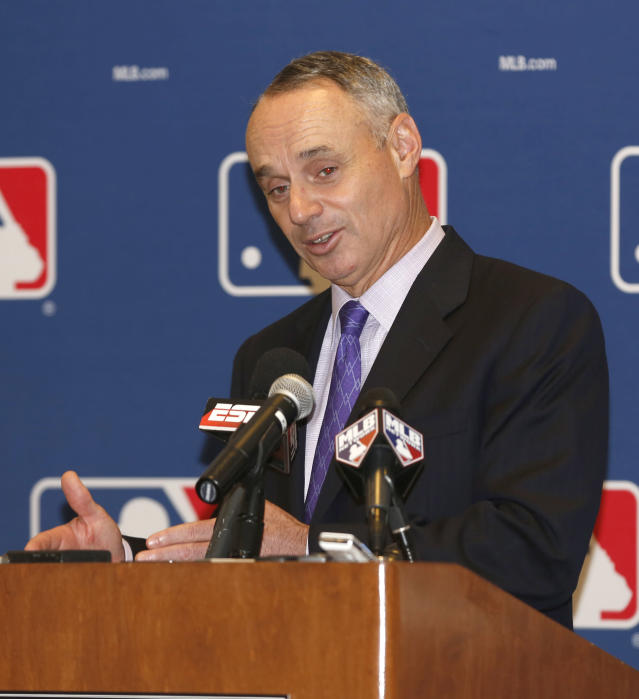Rob Manfred, Chief Operating Officer for Major League Baseball, talks to the media following baseball's general managers' meetings Thursday, Nov. 14, 2013, in Orlando, Fla. (AP Photo/Reinhold Matay)