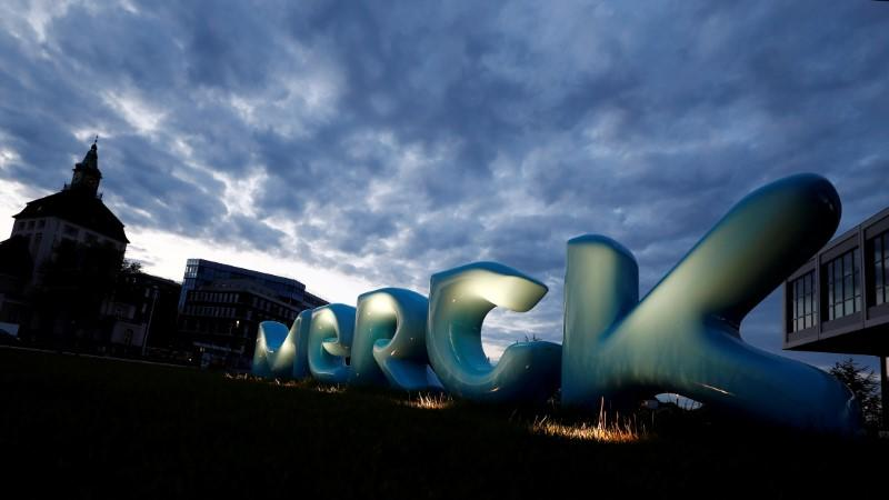 FILE PHOTO: The logo of German pharmaceuticals company Merck in front of the company's headquarters in Darmstadt