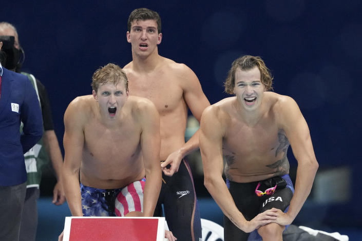 United States relay team react during the men's 4 x200-meter freestyle relay final at the 2020 Summer Olympics, Wednesday, July 28, 2021, in Tokyo, Japan. (AP Photo/Matthias Schrader)
