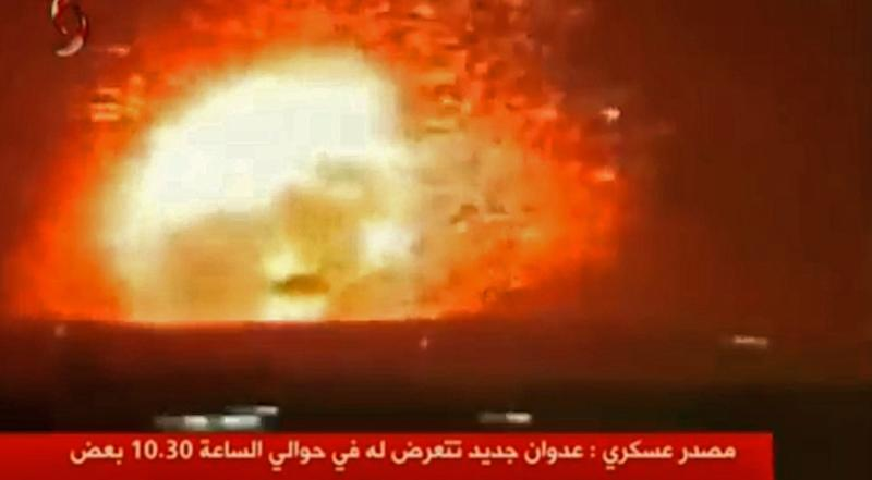 An image grab taken from the Syrian TV channel, Al-Ekhbariya Al-Souriya, on April 30, 2018 allegedly shows missile strikes targeting central Syria the previous night but without giving precise information about the exact location Missile strikes on central Syria killed 26 pro-regime fighters, most of them Iranians, a monitor said Monday, in a raid that bore the hallmarks of Tehran's archfoe Israel. According to the Syrian Observatory for Human Rights monitoring group, missile strikes hit two military targets in Aleppo and Hama provinces late on april 29. (AFP Photo/STRINGER)