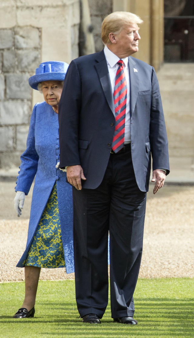 <p>Britain's Queen Elizabeth II, background and President of the United States Donald Trump walk from the Quadrangle after inspecting the Guard of Honour, during the president's visit to Windsor Castle, Friday, July 13, 2018 in Windsor, England. (Photo: Richard Pohle/Pool Photo via AP) </p>