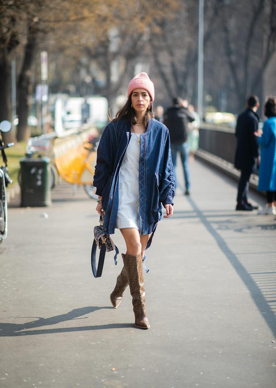 <p>If you're dealing with that in-between weather, a beanie is the perfect way to warm up your look without layering up too heavily. Simply pair it with a dress and boots, then top it all with a jacket or coat to pull it together. </p>