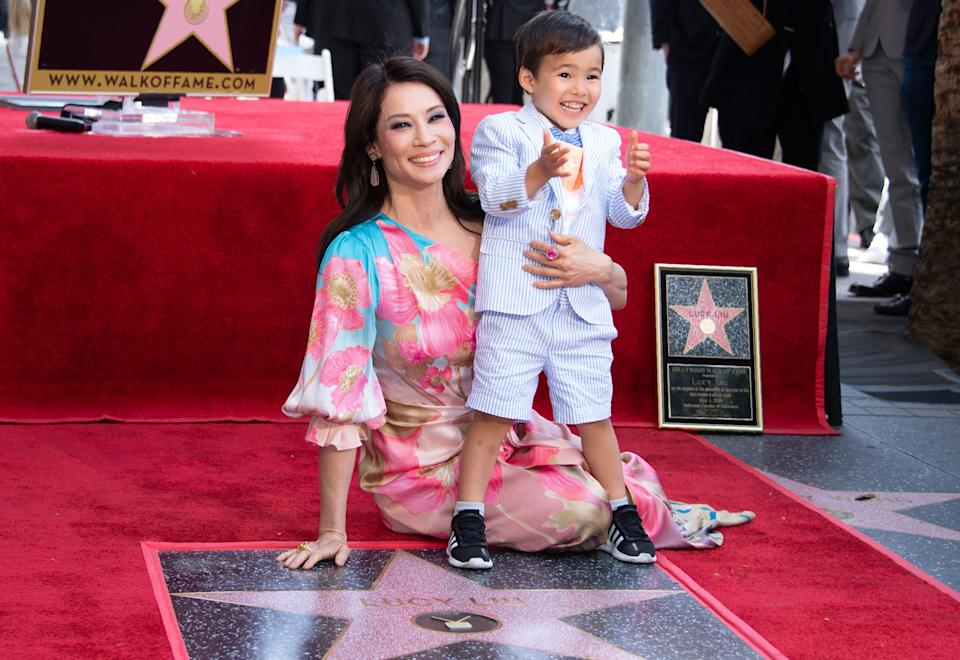 Lucy Liu and her son Rockwell Lloyd smile as she receives her star on the Walk of Fame during a ceremony in Hollywood in May 2019. (Photo: VALERIE MACON via Getty Images)