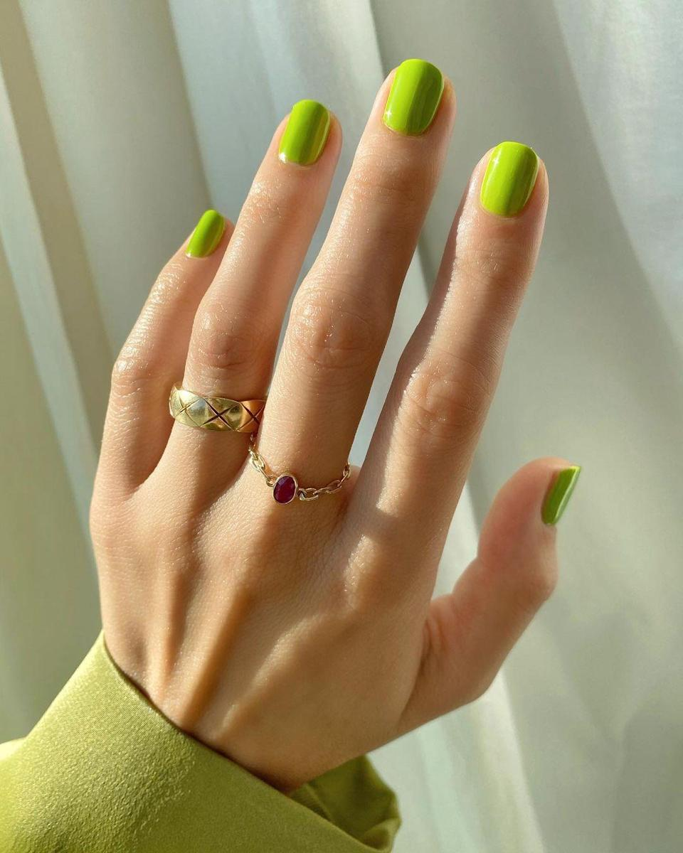 """There's no better year than 2020 to channel your inner Grinch. Nail artist Betina Goldstein used Pearnova's nail polish in <a href=""""https://www.pearnova.com/collections/classic-lacquer/products/one-piece-wonder"""" rel=""""nofollow noopener"""" target=""""_blank"""" data-ylk=""""slk:One Piece Wonder"""" class=""""link rapid-noclick-resp"""">One Piece Wonder</a> for the look above."""