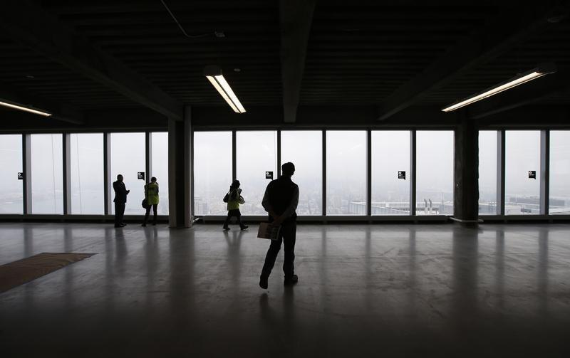 Members of the media tour an open unfinished floor space on the north side of the Durst Organization's newly unveiled marketing center in the One World Trade Center tower in New York